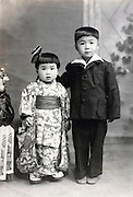 three years old girl made up for her Shichi Go San celebration with 5 year brother Japan 1950s