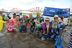 Loony Dookers Mathew Solway-Smith, Lawrie Warke, Kenny &amp; John Solway, Jimmy Solway and Clair Monkhouse take part in the annual Loony Dook swim in the Firth of Forth on New Years Day.<br /> <br /> &copy; Dave Johnston/ EEm