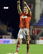 Blackpool Defender Tom Aldred celebrates during the Sky Bet League 1 match between Wigan Athletic and Blackpool at the DW Stadium, Wigan, England on 12 December 2015. Photo by Pete Burns.