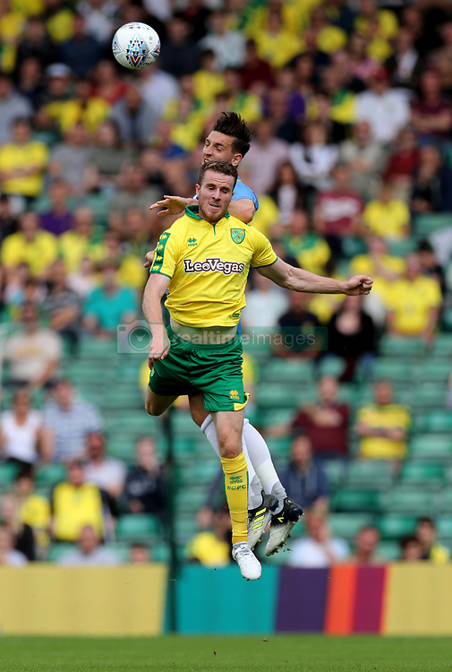 Norwich City's Marley Watkins is challenged by Brighton's Lewis Dunk during the pre-season match at Carrow Road, Norwich.
