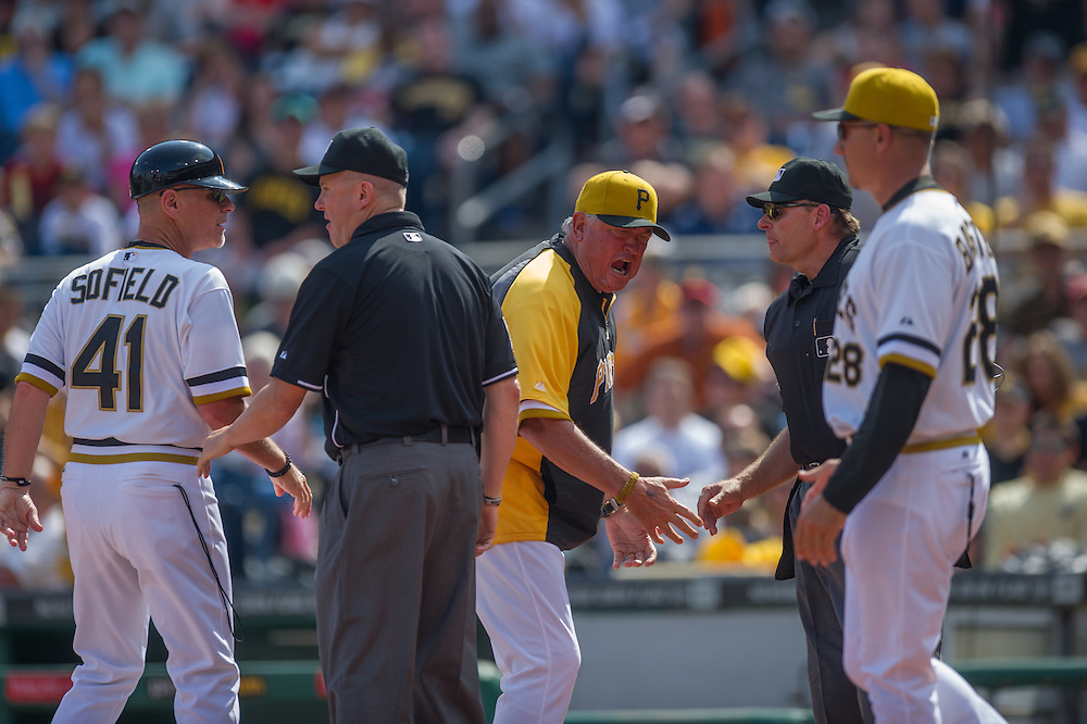 PITTSBURGH, PA - JUNE 08: Manger Clint Hurdle #13 of the Pittsburgh Pirates exchange emotions with home plate Ed Hickox  during the game against the Milwaukee Brewers at PNC Park on June 8, 2014 in Pittsburgh, Pennsylvania. (Photo by Rob Tringali) *** Local Caption *** ;Clint Hurdle;Ed Hickox