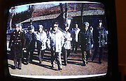 North Korea.<br />7 O'clock news Jan 2003. North Korean leader Kim Il Sung with military officers leads the nights news 29 Jan 2003. Shot off Hotel TV Pyongyang DPRK.<br /><br />Picture Credit: Dermot Tatlow