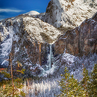 Bridalveil Falls and the Cathedral Rocks after a winter snow, Yosemite National Park, California.