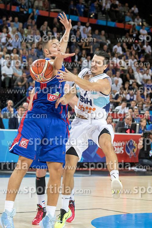 06.09.2015, Park Suites Arena, Montpellier, FRA, Bosnien und Herzegowina vs Frankreich, Gruppe A, im Bild JOFFREY LAUVERGNE (7), MARKO SUTALO (7) // during the FIBA Eurobasket 2015, group A match between Bosnia an Herzegowina and France at the Park Suites Arena in Montpellier, France on 2015/09/06. EXPA Pictures &copy; 2015, PhotoCredit: EXPA/ Newspix/ Pawel Pietranik<br /> <br /> *****ATTENTION - for AUT, SLO, CRO, SRB, BIH, MAZ, TUR, SUI, SWE only*****