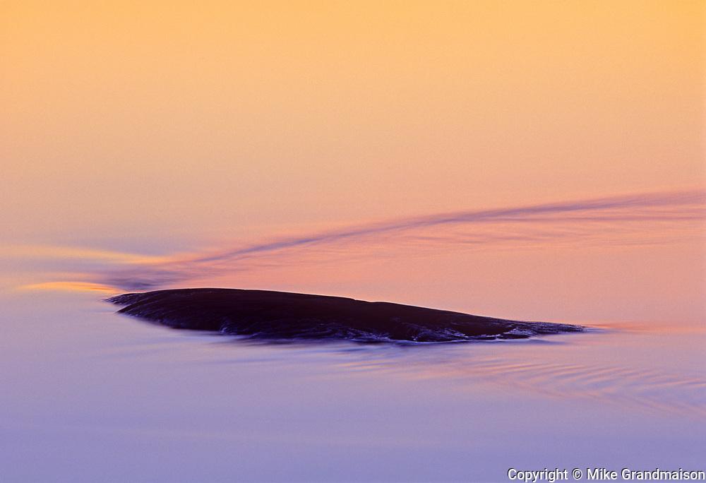 Sun setting on rock at Sasagiu Rapids, Sasagiu Rapids, Manitoba, Canada