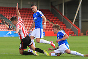 Sam Magri brings Billy Waters down the penalty during the Vanarama National League match between Cheltenham Town and Dover Athletic at Whaddon Road, Cheltenham, England on 12 September 2015. Photo by Antony Thompson.