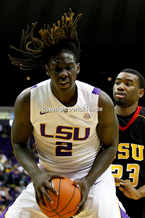 December 29, 2011; Baton Rouge, LA; LSU Tigers forward Johnny O'Bryant (2) is defended by Grambling State Tigers forward Demetri Wheeler (23) during the first half of a game at the Pete Maravich Assembly Center.  Mandatory Credit: Derick E. Hingle-US PRESSWIRE