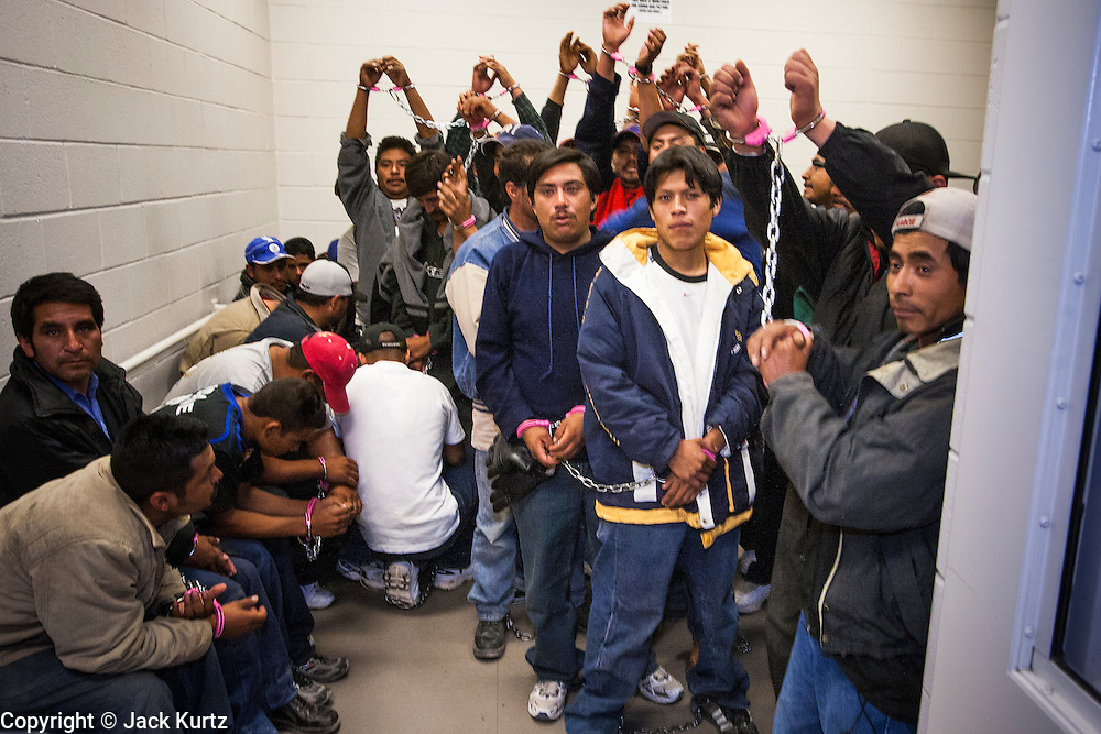 02 MARCH 2006 - Undocumented immigrants apprehended by the Maricopa County Sherrif's Dept. wait to be processed in the Madison Street Jail Thursday night. Fiftyfour immigrants were apprehended by MCSO deputies. PHOTO BY JACK KURTZ