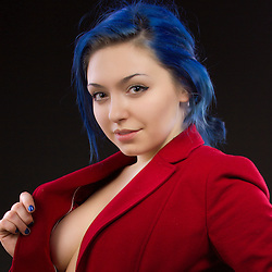 A beautiful young lady with bright blue hair and a red jacket showing what she's not wearing under the jacket.