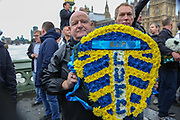 Leeds United wreath during the Football Lads Alliance march between Park Lane and Westminster Bridge, London on 7 October 2017. Photo by Phil Duncan.