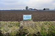 Nederland, Leuth, 16-2-2017Boerderij en landbouwgrond in de Ooijpolder te koop. Geeft aan hoe slecht het gaat met het boerenbedrijf. Veel boeren gaat het economisch slecht en veel agrariers besluiten tot verkoop van hun bedrijf. Foto: Flip Franssen