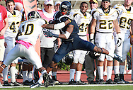 Samford wide receiver Kelvin Clay  (1) is grabbed by Appalachian State defensive back Demtrious McCray (10) at Seibert Stadium in Homewood, Ala., Saturday, Oct 13, 2012. (Marvin Gentry)