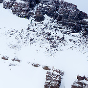 Skiers including Hadley Hammer hiking the East Face of No Name Peak in the Teton backcountry.