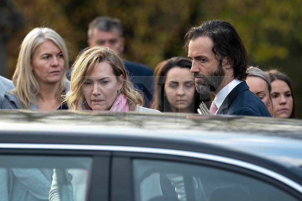 © Licensed to London News Pictures . 30/10/2018. Accrington , UK . The actress KATE WINSLET leaves the crematorium with her husband EDWARD SMITH (aka NED ROCKNROLL ) after the service . The funeral of Gemma Nuttall at Accrington Crematorium . Gemma died of cancer despite initially seeing off the disease after radical immunotherapy treatment in Germany , paid for with the fundraising support of actress Kate Winslet , who read of Gemma's plight on a crowdfunding website shortly after she lost her own mother to cancer . Permission to photograph given by Gemma's mother , Helen Sproates . Photo credit : Joel Goodman/LNP