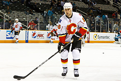 March 23, 2011; San Jose, CA, USA;  Calgary Flames right wing Tom Kostopoulos (16) warms up before the game against the San Jose Sharks at HP Pavilion. Mandatory Credit: Jason O. Watson / US PRESSWIRE
