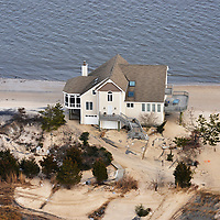 House on the north end of Shore Dr., Prime Hook Beach, DE.  The houses have been washed under the by storm surge.