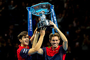 Nicolas Mahut of France (right) and doubles partner Pierre-Hugues Herbert with their winners trophy during the Nitto ATP finals at the O2 Arena, London, United Kingdom on 17 November 2019.
