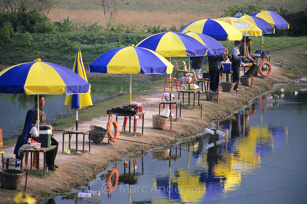 People fishing at a fish farm, Hong Kong, China.