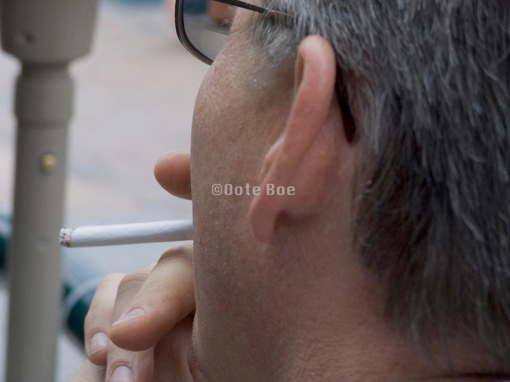 close up of man smoking