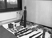 Garda Arms Find.1982.02.02.1982..02.02.1982.2nd February 1982.Picture taken at Garda Headquarters Phoenix Park ,Dublin. .Gardai display  their find of Firearms, ammunition and explosives   ...The haul which included armalite rifles and a home made rocket also included a poster depicting the 1981 Hunger Striker, Kieran Doherty.