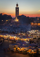 Djemaa El Fna Square in the medina of Marrakesh at dusk. The square is a Unesco World Heritage site. http://www.gettyimages.com/detail/photo/bright-lights-big-city-royalty-free-image/481202101