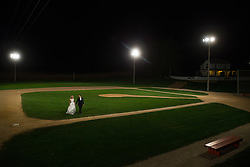 Shannon and David celebrate their wedding at the Field of Dreams movie site in Dryersville, Saturday, Oct. 10, 2015. Photo by Justin Edmonds