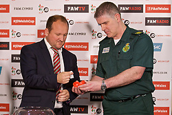CARDIFF, WALES - Monday, October 3, 2016: FAW's head of competitions with two members of the Welsh Ambulance Service conduct the draw for the 2nd Round of the Welsh Cup at the Vale Resort. (Pic by David Rawcliffe/Propaganda)