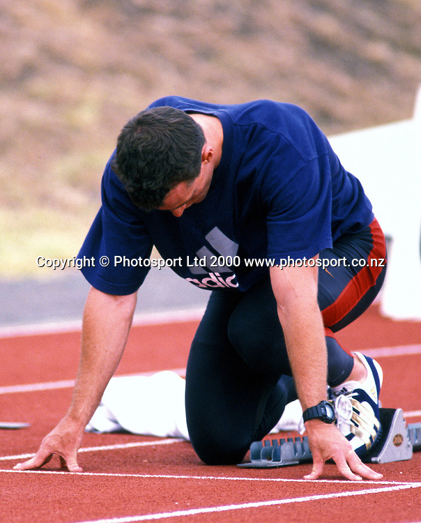 A sprinter waits in the starting blocks, Track and Field, Athletics, Marley Games, 2000. Photo: PHOTOSPORT
