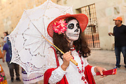 A woman wearing a skeleton costume parade during the Day of the Dead Festival known in spanish as Día de Muertos October 28, 2014 in Oaxaca, Mexico.