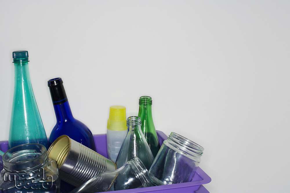 Empty bottles and cans in container close-up