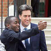 Ed Miliband <br /> Leader of the Labour Party <br /> Campaign Event at The Royal Horticultural Halls, 80 Vincent Square, London, SW1P 2PE<br /> 2nd May 2015 <br /> <br /> Ed Miliband MP <br /> Labour Leader <br /> General Election Campaign 2015 <br /> <br /> on his way out selfie with an activist <br /> <br /> <br /> Photograph by Elliott Franks <br /> Image licensed to Elliott Franks Photography Services
