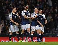 Football - 2016 / 2017 World Cup Qualifier - UEFA Group F: Scotland vs. Slovenia<br /> <br /> Scott Brown of Scotland celebrates with Chris Martin, Charlie Mulgrew and James Forrest after the match at Hampden Park.<br /> <br /> COLORSPORT