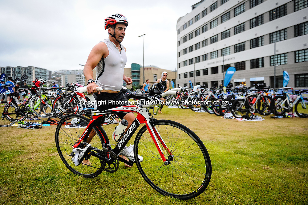A competitor on the bike leg of the Sovereign Tri Series, Waterfront, Wellington, New Zealand. Saturday 14 March 2015. Copyright Photo: Mark Tantrum/www.Photosport.co.nz