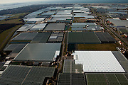 Nederland, Zuid-Holland, Westland, 20-03-2009; kassen in Polder Het Nieuwland tussen 's-Gravenzande en Hoek van Holland, links aan de horizon. Ook links aan de horizon ingang Nieuwe Waterweg en Maasvlakte. Air view on the glasshouses in the heart of the horticultural area in the polder between the villages 's-Gravenzande and Hoek van Holland (l). North Sea on the horizon..Swart collectie, luchtfoto (toeslag); Swart Collection, aerial photo (additional fee required); .foto Siebe Swart / photo Siebe Swart