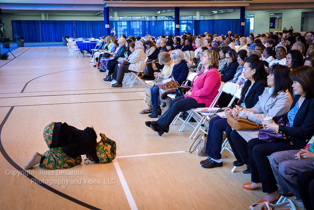 Bernadette Ekepepe of Newark, NJ, went to her knees in prayer. The Women's Commission of the Archdiocese of Newark held a Day of Reflection on April 26, 2014 at the Ritchie Regan Recreation and Athletic Center on the campus of Seton Hall University, South Orange, NJ. /Russ DeSantis Photography and Video, LLC
