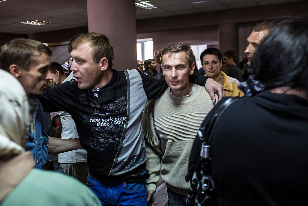 MARIUPOL, UKRAINE - MAY 11: Men inside a polling station on May 11, 2014 in Mariupol, Ukraine. A referendum on greater autonomy is being held after pro-Russian activists took over at least ten cities in the eastern part of the country. (Photo by Brendan Hoffman/Getty Images) *** Local Caption ***