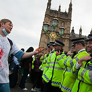 The blocking of Westminster Bridge is over but police is only letting people leave south side not to have any spilling into Parliament Sqaure. This protestor is denied leaving North way  and he is trying to get into a converstion with police on Government policies..The Health and Care Bill has been passed by Parliament and is due to go to the House of Lords. In protest against the bill which aim to deconstruct and privatise large parts of the NHS UK Uncut activists together with health workers and trade unionists blocked the Westminster Bridge from 1pm til 5.30pm.