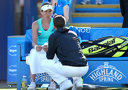 Johanna Konta of Great Britain talks with her trainer in between games after falling during the match - Mandatory by-line: Paul Terry/JMP - 24/06/2016 - TENNIS - Devonshire Park - Eastbourne, United Kingdom - Karolina Pliskova v Johanna Konta - Aegon International Eastbourne