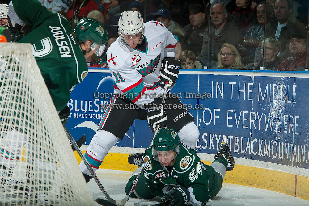 KELOWNA, CANADA - DECEMBER 30: Jordan Borstmayer #11 of Kelowna Rockets digs for the puck around Lucas Skrumeda #24 of Everett Silvertips on December 30, 2015 at Prospera Place in Kelowna, British Columbia, Canada.  (Photo by Marissa Baecker/Shoot the Breeze)  *** Local Caption *** Lucas Skrumeda; Jordan Borstmayer;