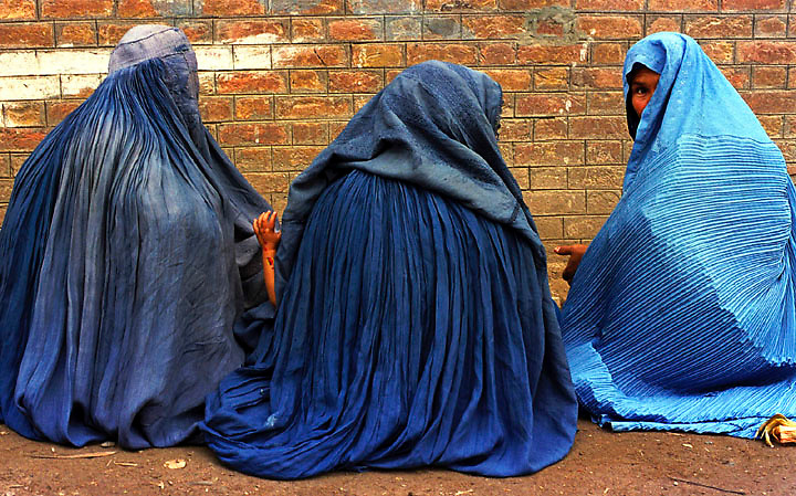 A Vieled Patience - Afghan women wait outside the United Nations High Commission for Refugees hoping to be admitted into one of the several refugee camps that surround the Pakistani city of Peshawar.  Pakistan is home to an estimated 2 million Afghans who have fled the drought and war.