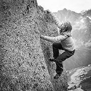 French Mountain Guide Cecile Thomas bouldering on the Plan d'Aiguille above Chamonix in the French Alps