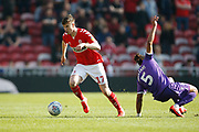 Middlesbrough midfielder Paddy McNair (17) goes pastStoke City defender Ashley Williams (5) during the EFL Sky Bet Championship match between Middlesbrough and Stoke City at the Riverside Stadium, Middlesbrough, England on 19 April 2019.