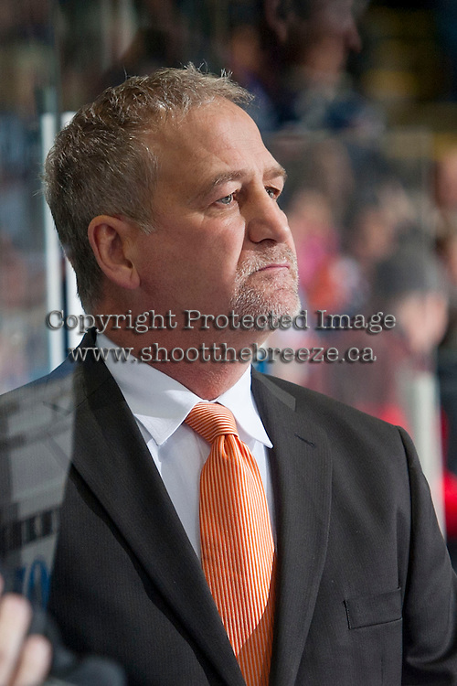 KELOWNA, CANADA - NOVEMBER 30: Dave Hunchak, head coach of the Kamloops Blazers stands on the bench opposite the Kelowna Rockets on November 30, 2013 at Prospera Place in Kelowna, British Columbia, Canada.   (Photo by Marissa Baecker/Shoot the Breeze)  ***  Local Caption  ***