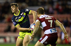 Wigan Warriors' Sam Powell (right) and Wakefield Trinity Jordan Crowther during the Betfred Super League Super 8's match at the DW Stadium, Wigan.