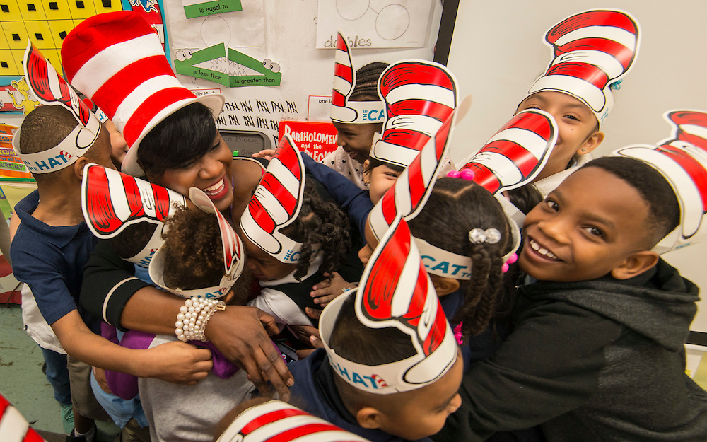 Houston ISD trustee Wanda Adams is hugged by students during a Read Across America program at Anderson Elementary School, March 2, 2017.