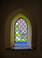 Peering out through the centuries from the church foyer