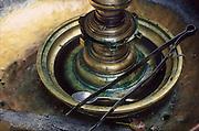 Sri Lanka. Detail of a brass lamp at a Buddhist Temple.
