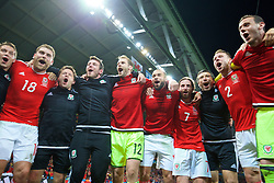 LILLE, FRANCE - Friday, July 1, 2016: Wales players celebrate in the team huddle following a 3-1 victory over Belgium and reaching the Semi-Final during the UEFA Euro 2016 Championship Quarter-Final match at the Stade Pierre Mauroy. Sam Vokes, physiotherapist David Weeks, Ronan Kavanagh, goalkeeper Owain Fon Williams, Ashley 'Jazz' Richards, Joe Allen, head of performance Ryland Morgans, Chris Gunter, goalkeeper Daniel Ward. (Pic by David Rawcliffe/Propaganda)