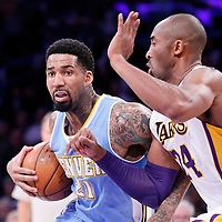 23 November 2014: Denver Nuggets forward Wilson Chandler (21) drives past Los Angeles Lakers guard Kobe Bryant (24) during the Los Angeles Lakers season game versus the Denver Nuggets, at the Staples Center, Los Angeles, California, USA.