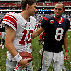October 10, 2010; Houston, TX USA; New York Giants quarterback Eli Manning (10) meets with Houston Texans quarterback Matt Schaub (8) following a game at Reliant Stadium. The Giants defeated the Texans 34-10. Mandatory Credit: Derick E. Hingle